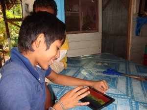 children on tablet in Belize