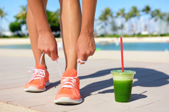 lacing up shoes and green juice