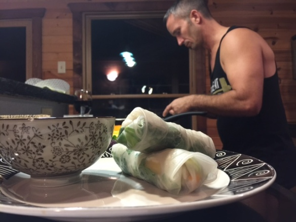 Joe rolling together the mango, avocado, and rice spring rolls