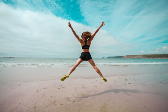 jumping on beach